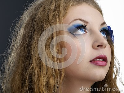 Person feminine model with sensual lips and expressive eyes clos