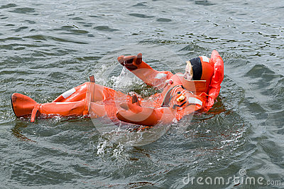 Person floating in survival suit Editorial Stock Image