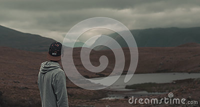 Person In Gray Hoodie Standing Before Brown Earth Field Free Public Domain Cc0 Image