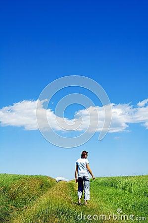 Person in green field 5