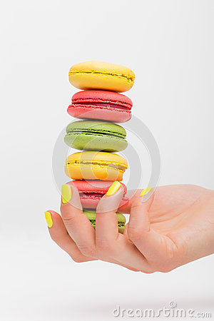 Free Person Holding Different Macaroons Stock Photo - 70553500