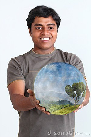 Person holding glowing ball containing ecosystem