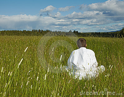 Person is meditation far away from civilization