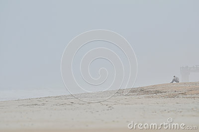 Person on misty beach