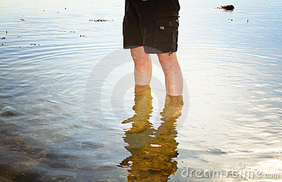 Person paddling in sea