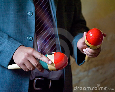Person playing maracas