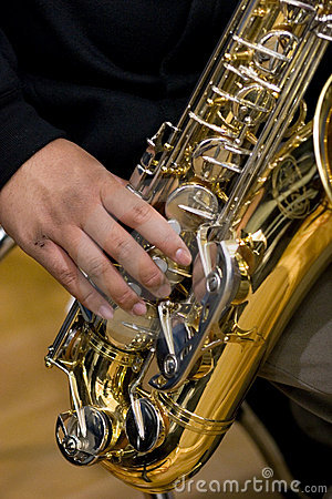 Person playing a saxophone