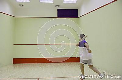 Person playing squash