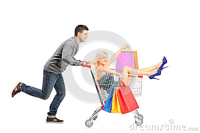 Person pushing a cart, woman with bags in it