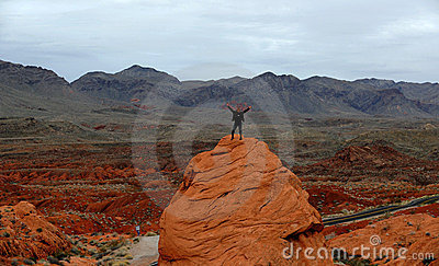 The person on a red rock.