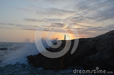 Person On Rocky Coastline At Sunset Free Public Domain Cc0 Image