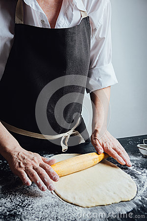 Person rolling homemade cookie dough