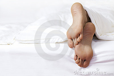 Person s foot in bed