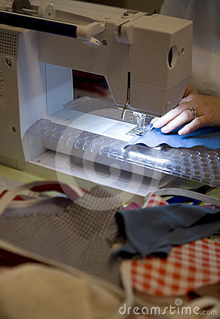 Person on sewing machine making bunting