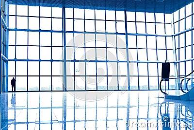 Person silhouette in glass corner