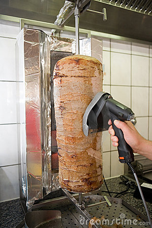 Person slicing kebab meat