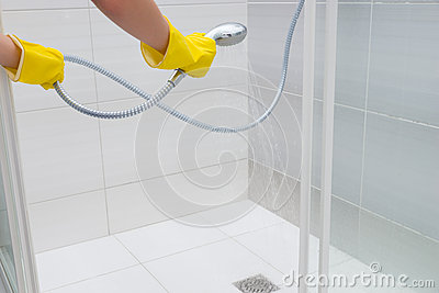 Person Spraying Water With Hand Held Shower Head Stock
