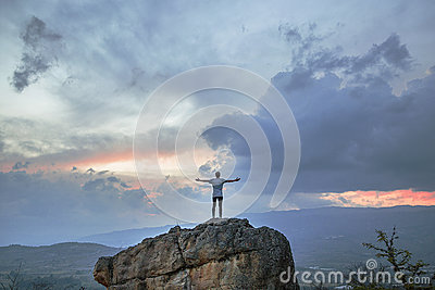 Person Standing On Concrete Stone Under White Clouds During Sunset Free Public Domain Cc0 Image