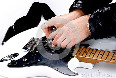 Person tuning a guitar