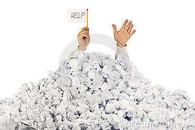 Person under crumpled pile of papers