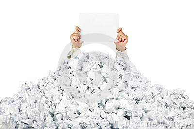 Person under crumpled pile of papers with a blank