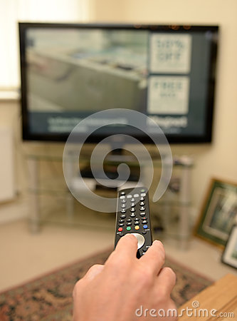 Free Person Using TV Remote Control Stock Photos - 37737373