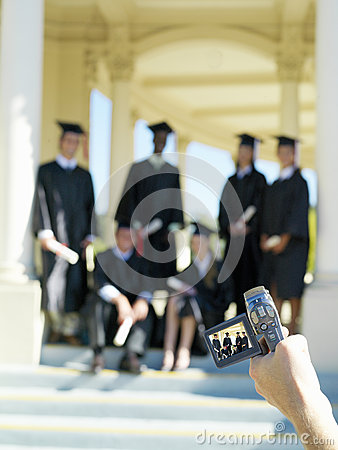 Free Person Video Taping Young People Graduating In Caps And Gowns Royalty Free Stock Images - 41711409