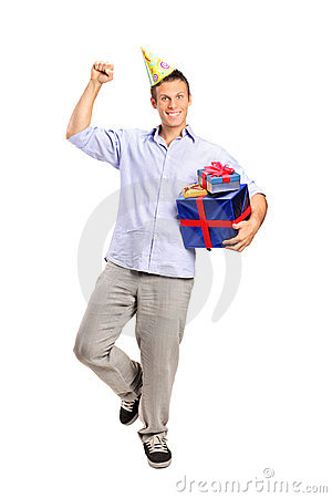 Person wearing a party hat and holding a gift