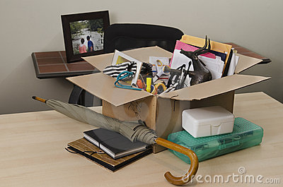Personal property in carton on desk