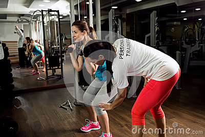 Personal trainer exercise and shows how to workout training Stock Photo