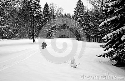 Persons Walking Through The Deep Snow