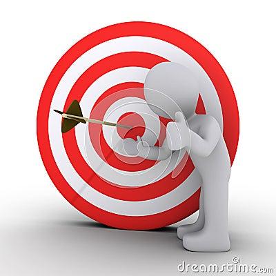 Persoon die een pijl in het centrum van doel toont