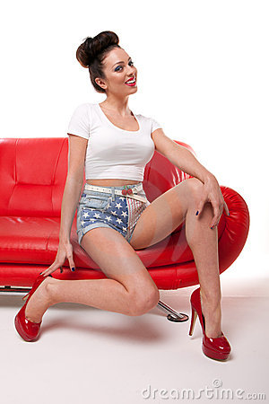 Pert Pinup Girl On Red Sofa