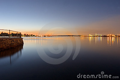 Perth dusk sunset on swan river with cityline