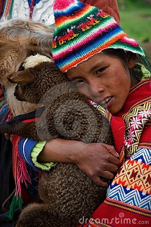 The Peruvian girl and the kid of the Lama. Editorial Photo