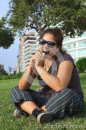 Peruvian Woman Bitin on Mobile Phone
