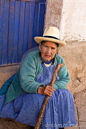 Peruvian woman sits on a step Pisac, Peru Editorial Image