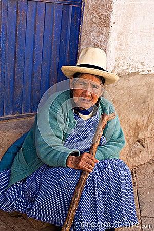 Peruvian woman sits on a step Pisac, Peru Editorial Image