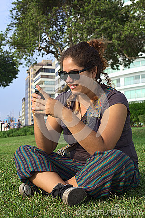 Peruvian Woman Texting with Mobile Phone