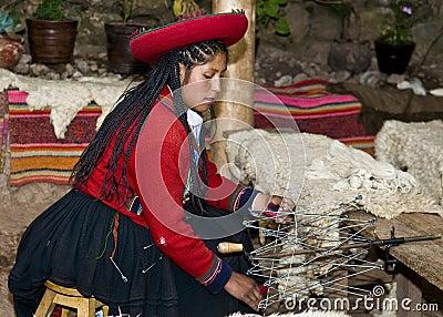 Peruvian woman weaving Editorial Stock Image