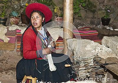 Peruvian woman weaving Editorial Image