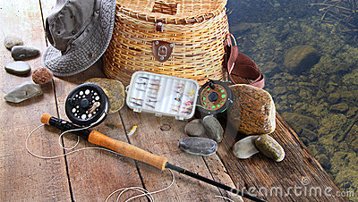 Pesca de señuelos, del carrete, y del sombrero del sol
