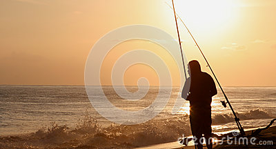Pescador en la puesta del sol Hawaii
