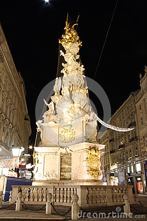 Pestsäule on Graben street in Vienna at night Editorial Stock Image
