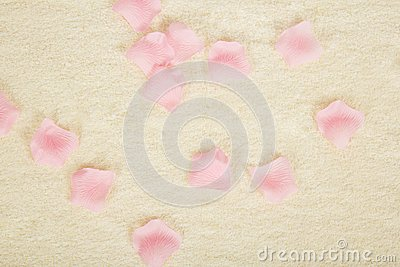 Petals of roses and towel. Background