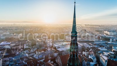 Petera Baznica Timelapse Riga city Church sunrise buildings Old Down Town Drone. Riga city Autumn buildings church Drone flight above and sunrise in the town stock footage