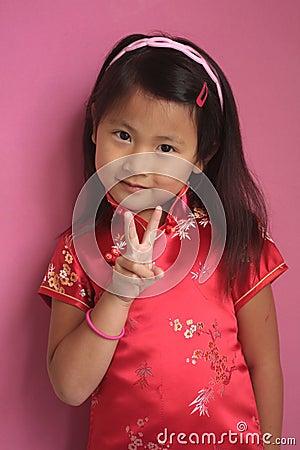 petite fille chinoise avec la robe rouge images libres de droits image 10630649