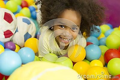 petites filles noires dans la salle de jeux photo stock. Black Bedroom Furniture Sets. Home Design Ideas