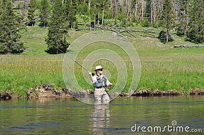Pezzo fuso maggiore del fisherwoman fotografia stock for Cabine del fiume kenai soldotna ak