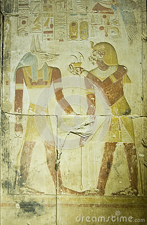Pharaoh Seti offering to Anubis